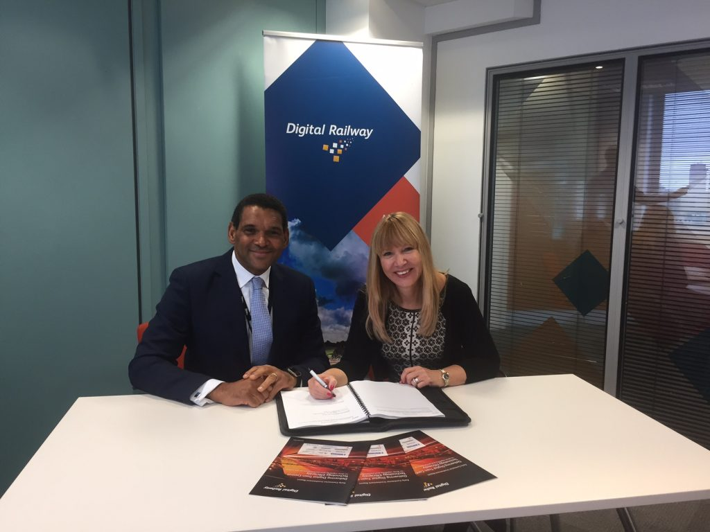 David Waboso, group managing director for Digital Railway and Anna Ince, chief executive officer at Resonate signing the two year contract. Credit: Network Rail.