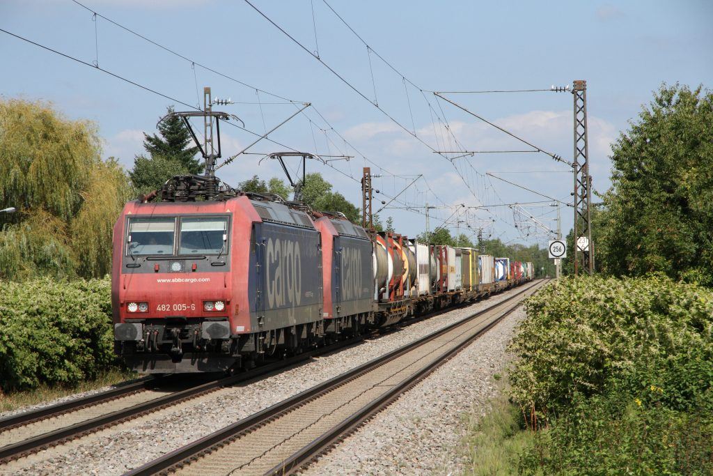 SBB Cargo Class 482 TRAXX locos haul a freight train over the route in September, 2016.