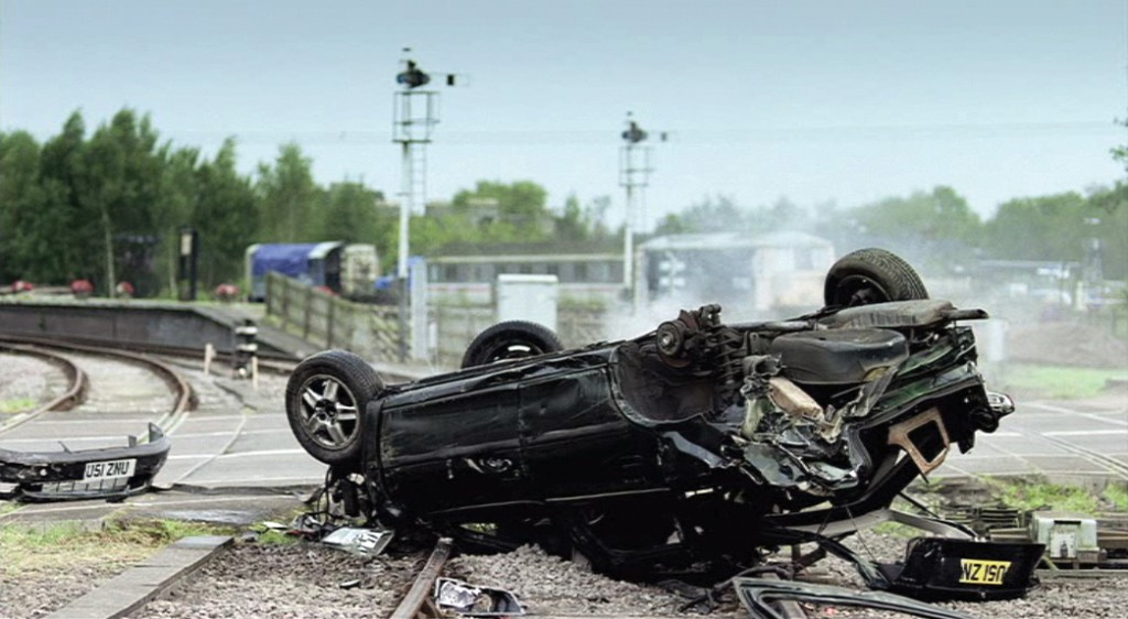 7. Still image of upturned car from TV advert [online]